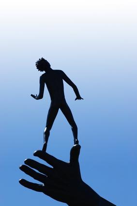 a boy standing on a hand